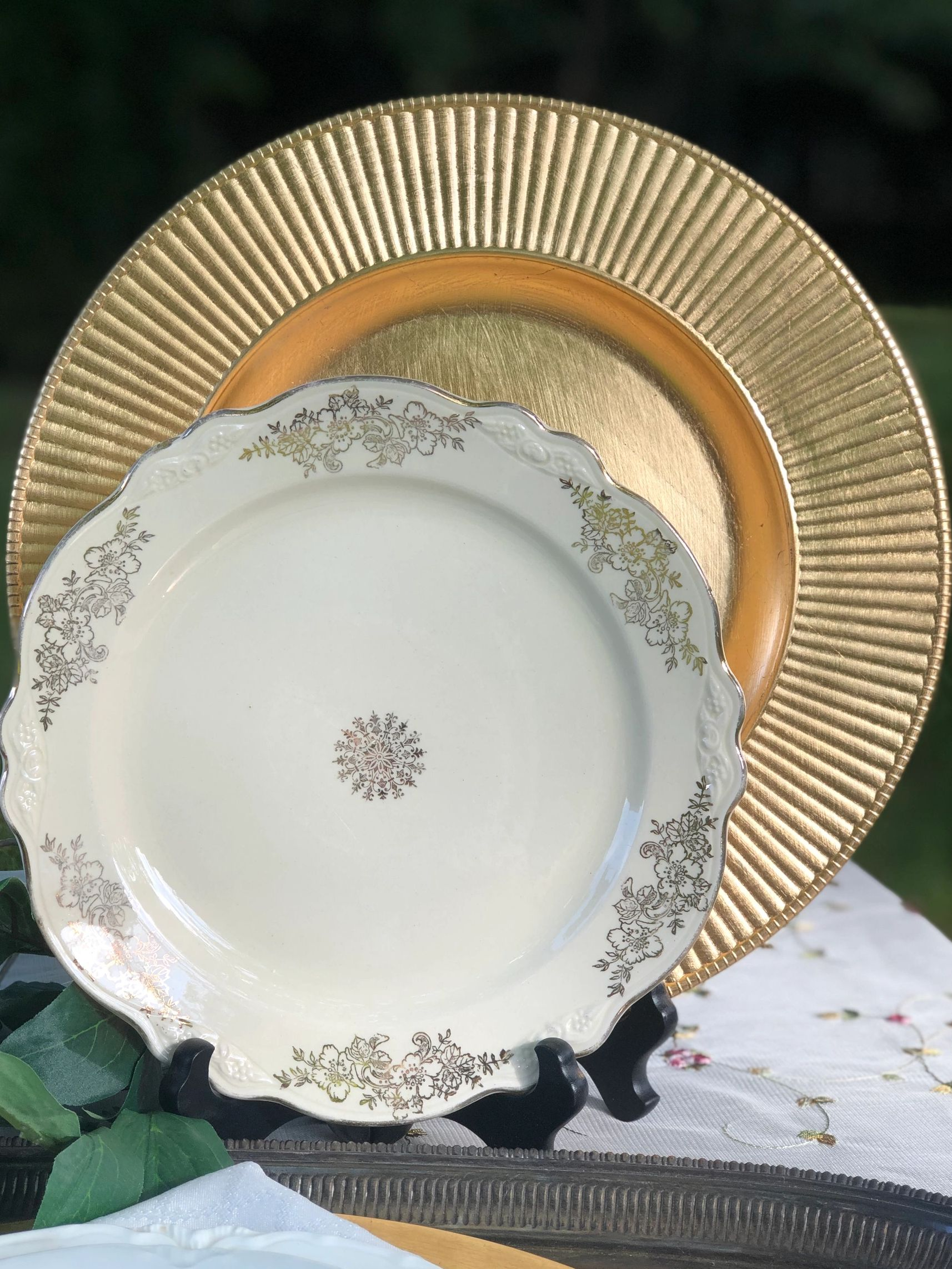 gold charger and antique dinner plate.