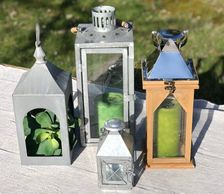 group of wood and metal lanterns