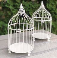 two white decorative birdcages