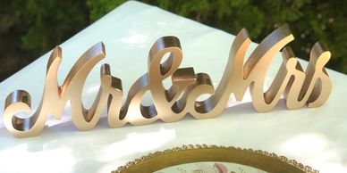 Gold Mr. & Mrs. tabletop sign.