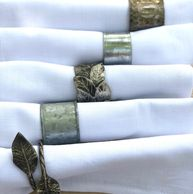 galvanized metal napkin rings on white cloth napkins