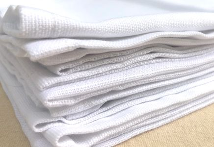 stack of white cloth napkins