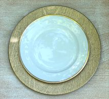 gold rimmed white plate on gold wood grain charg