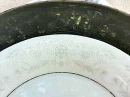 gray and white flowered plates