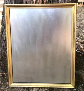 large gold frame mercury-style mirror.