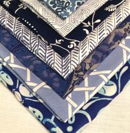 mix of blue and white patterned napkins