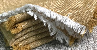 gold cloth napkin with fringe