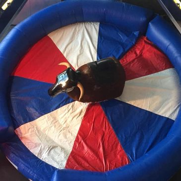 Aerial view of BullMan Mechanical Bull surrounded by a red white and blue inflatable crash mat
