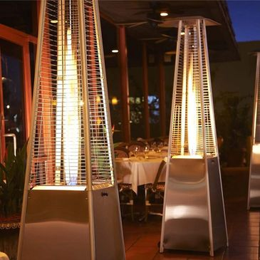 heaters in an outdoor dining area at a restaurant