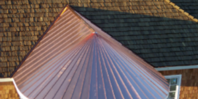 Radius copper roof with cedar shake roof and siding