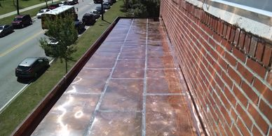 Flat seam copper roof with built in gutter. All soldered.