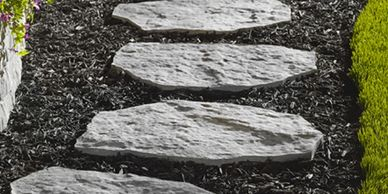 Landscaping winnipeg. patios winnipeg. walkways made with rock or mulch with step stones.