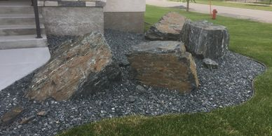 Winnipeg Landscaping Company. Granite Rock Boulders and Sod Installation in Winnipeg.