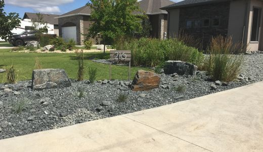 Landscaping in winnipeg. Winnipeg landscaping with rock and boulders. Sod Winnipeg.