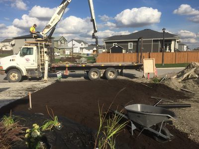 Landscaping in Winnipeg starting with soil, mulch, perennials, boulders and rock.