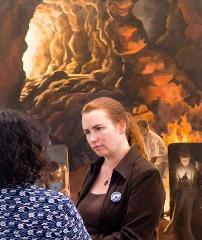 Lalita discussing her oil painting 'Plato's Cave' at an exhibition in Guiyang, China. Ted Nodwell