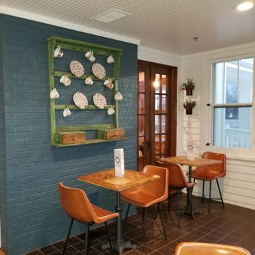 Fresh, clean, and quaint are some words to describe our dining rooms.