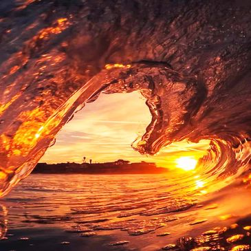 Sunshine inside a breaking wave. Photo by Hernan Pauccara from Pexels.