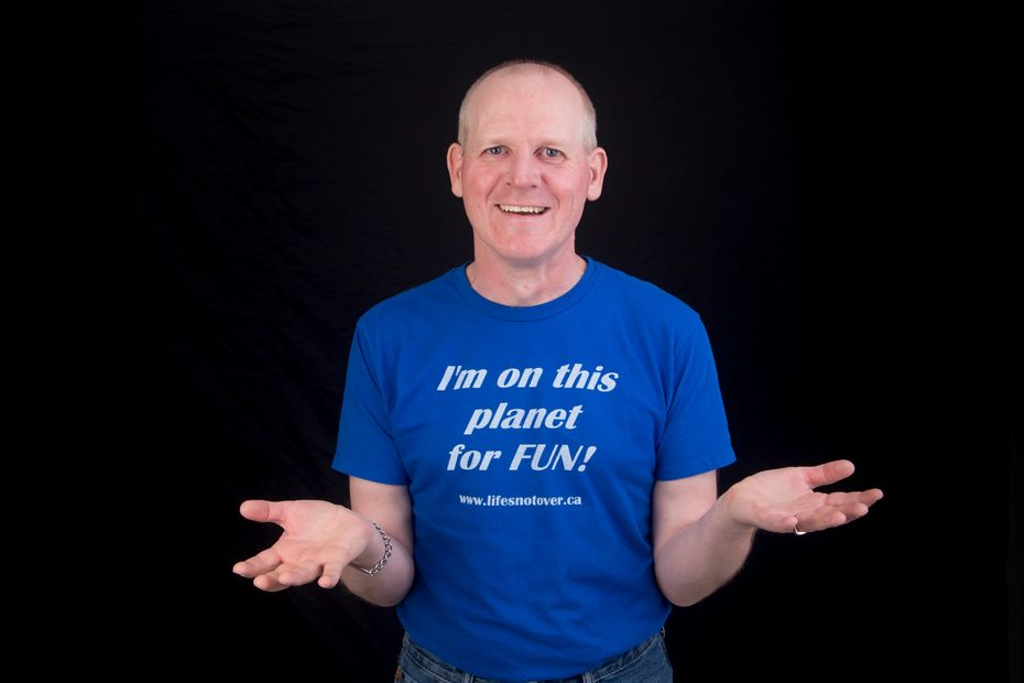 Image shows Christopher in a blue shirt with white lettering that says, I'm on this planet for fun.