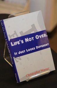A close up photo of Life's Not Over, It Just Looks Different, on a book stand.