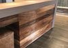 Concierge Desk - Textured Walnut Panels
