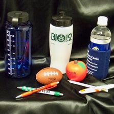 Customizeable promotional items including water bottles, stress balls, pens, and koozies.