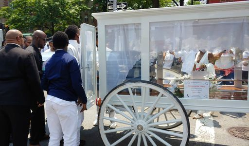 White horse drawn hearse with new white curtains