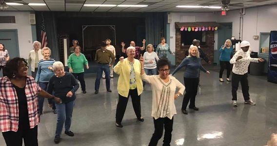 A group of our members enjoying a dance class together.