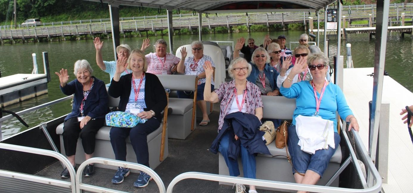 Senior citizens on a boat ride.