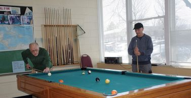 Our senior members enjoying a game of billiards at one of the Weston billiard tables.