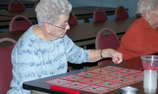Senior woman playing a fun game of bingo at Weston Senior Center.