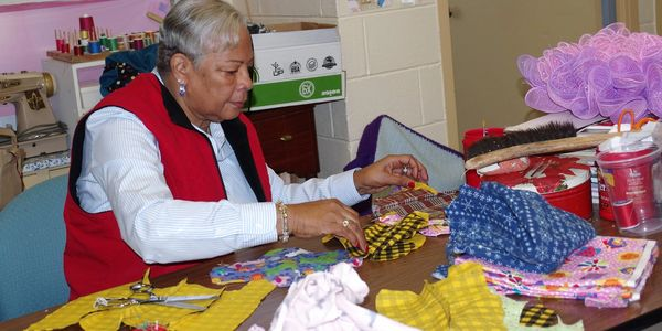 Senior citizen quilting at Weston Senior Center.