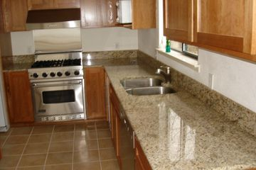 Custom Kitchen remodel with undermount sink, granite tops, tile floor and custom hardwood cabinets with stainless appliances