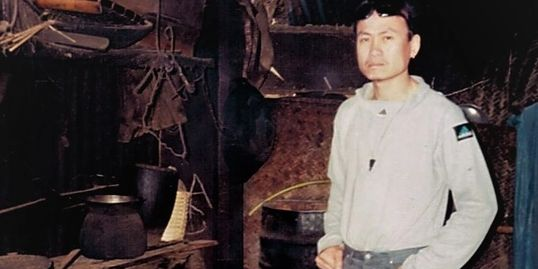 Oudom pictured standing in his mother's kitchen at her restaurant in 1998.