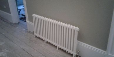 Radiator and central heating pipework installation