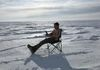 DJ enjoying a good book and some warm sun on the North Slope of Alaska. It was around -40F when this picture was taken.