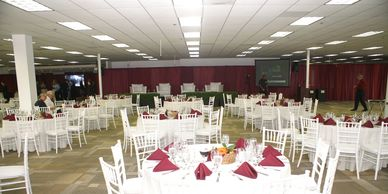 party rentals, chairs, tables, linens, drape, banquet tables, round tables, plates, forks, knives.