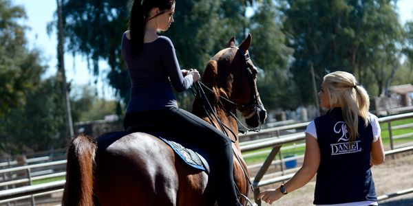 Giving a Riding horseback riding lesson