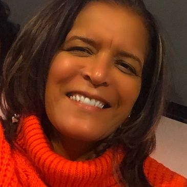 attractive black woman in an orange sweater