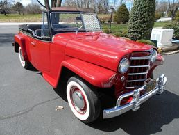 1950 Willys Jeepster. CAMPUS RED With black band. Very nice restoration. See Next Photo & Info.