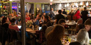 People dining inside Wild Rose
