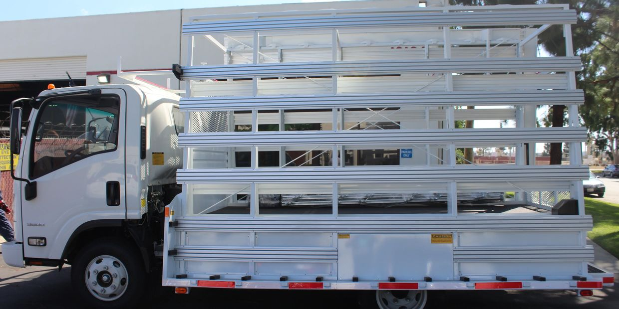 chassis-mounted weldco glass rack on an isuzu lcf cab chassis