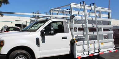aluminum glass holding stakes/poles on a weldco chassis-mounted glass rack