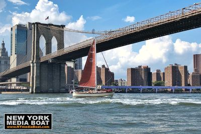 The Genesis of Narwhal Yacht Charters sailing underneath the Brooklyn Bridge!