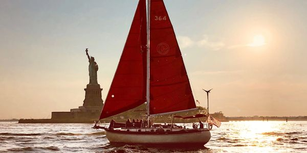 The Genesis of Narwhal Yacht Charters sailing by the Statue of Liberty!