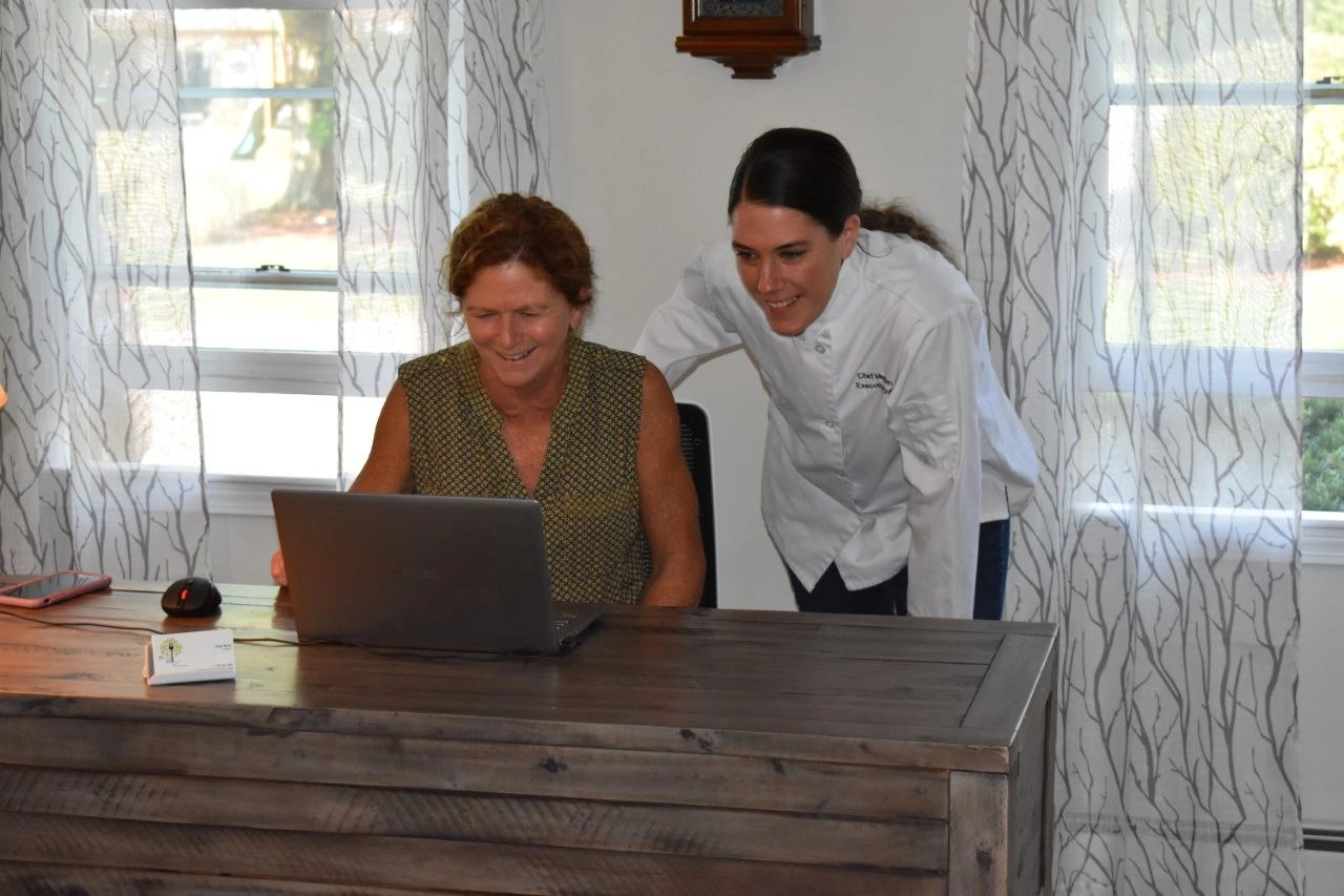 Judy and Chef Meghan reviewing events for the upcoming week
