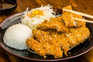 Katsu plate served with rice and cabbage salad