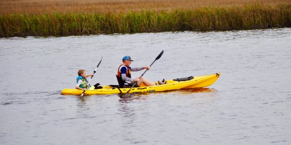 Father and son paddling a kayak in the Low-Country