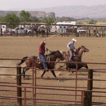 Warren Adams with a frieind at a roping contest (rodeo).