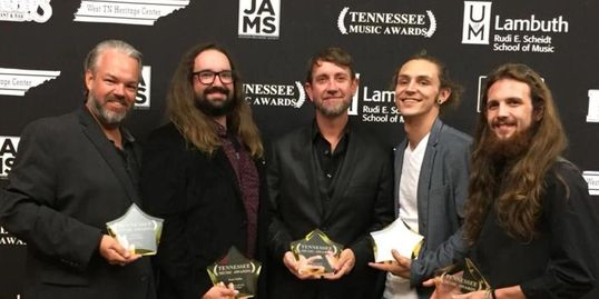 The Bryan Moffitt Band poses with their awards.